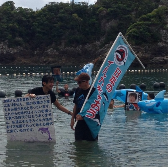 "Taiji: Another powerful image of Japanese activists and  Ric O""Barry taking a stand at the Cove during bottlenose dolphin roundup. 9/1/13"